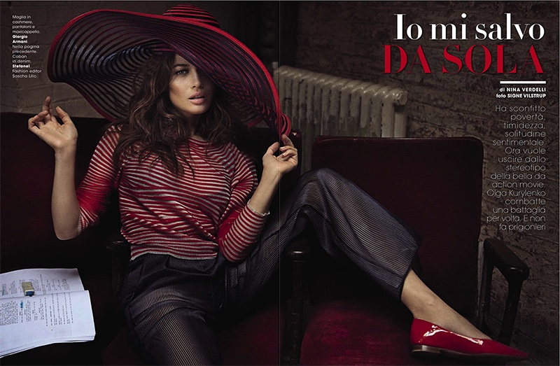Olga poses in wide-brimmed hat, blouse and pants from Giorgio Armani
