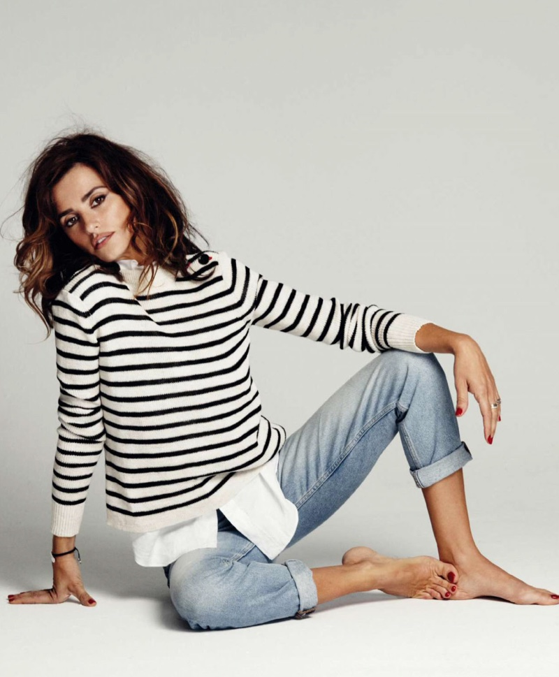 Penelope poses in a striped Isabel Marant sweater with light wash denim from Levi's
