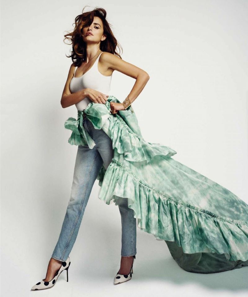 Penelope brings a touch of drama to her Levi's denim look with a Roberto Cavalli ruffles