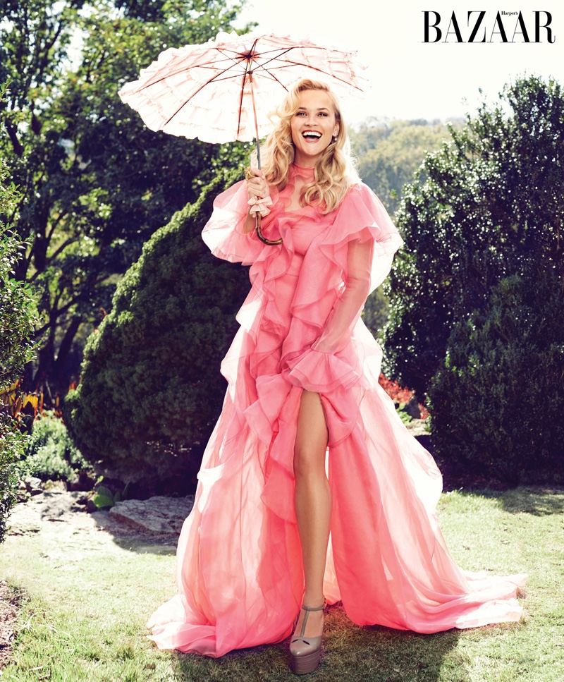 Reese Witherspoon looks pretty in pink wearing a Gucci gown with ruffles