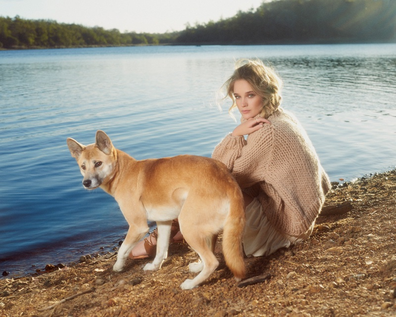 LAKE TIME: Posing with a dingo lakeside, Rosie wears a cozy sweater look