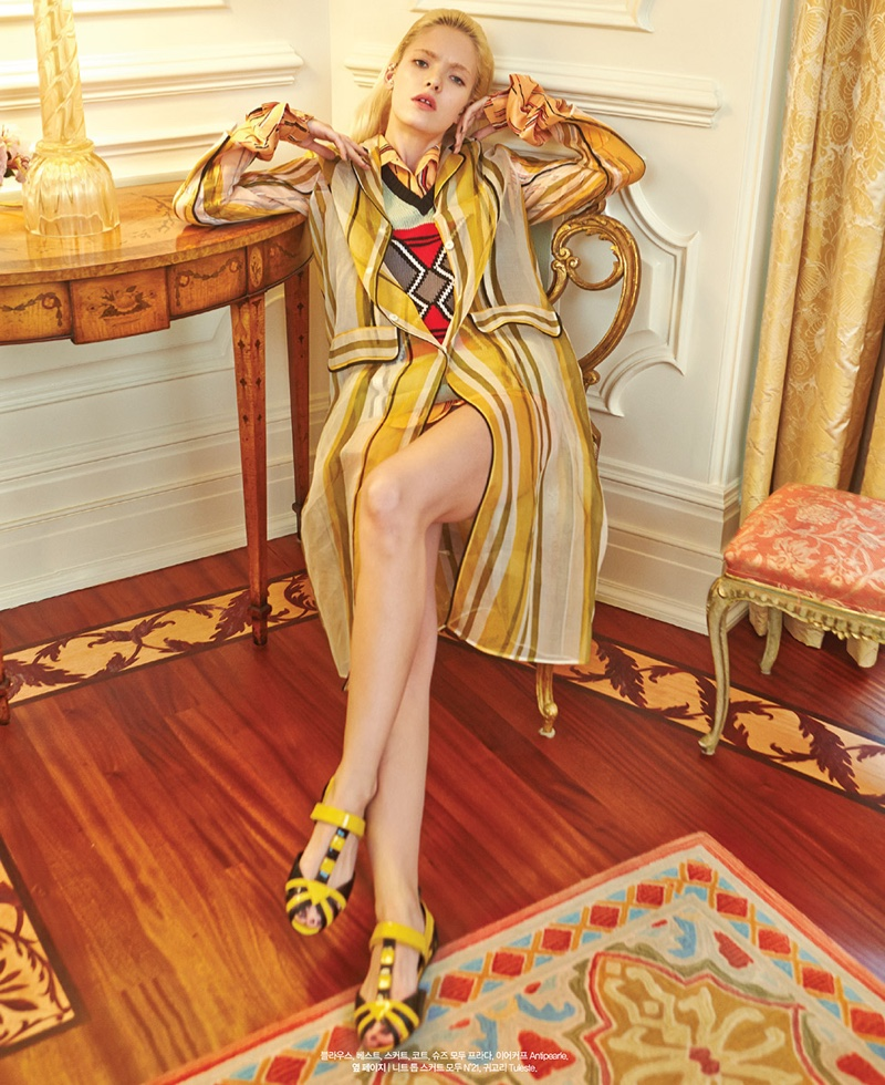 Anastasia models striped jacket and skirt from Prada's spring collection