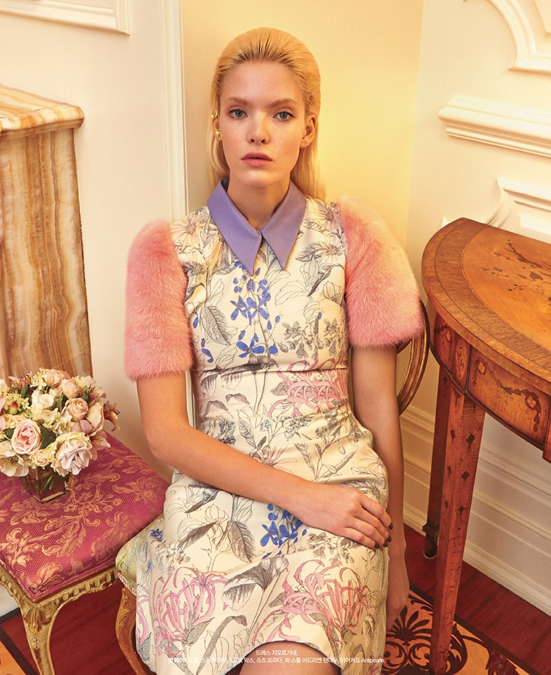 Anastasia looks pretty in pastels wearing a floral print dress with fur sleeves