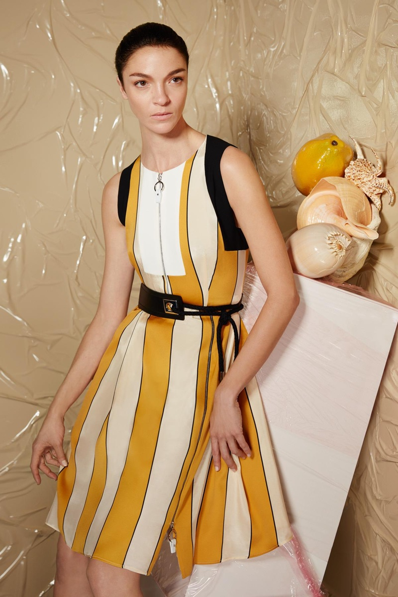 Mariacarla poses in bi-color Vello dress and Patty belt from Sportmax