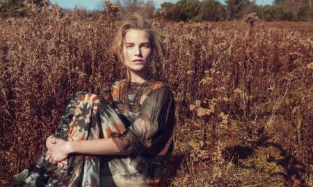 Suvi poses in a field wearing abstract print dress from Valentino