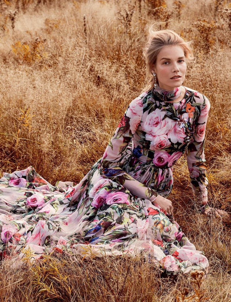 The model wears a floral print maxi dress with long sleeves