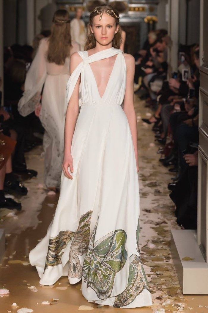 A Model Walks The Runway At Valentino S Spring 2016 Haute Couture Show Wearing White Gown