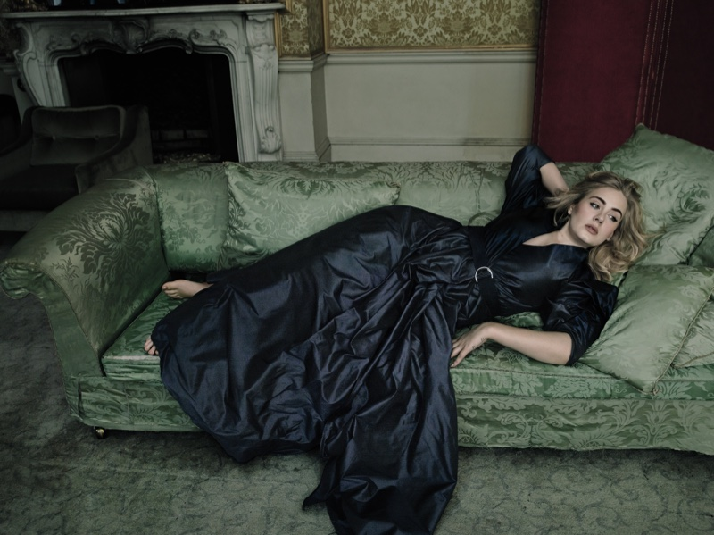 Adele poses in Alexander McQueen dress for Vogue's March issue