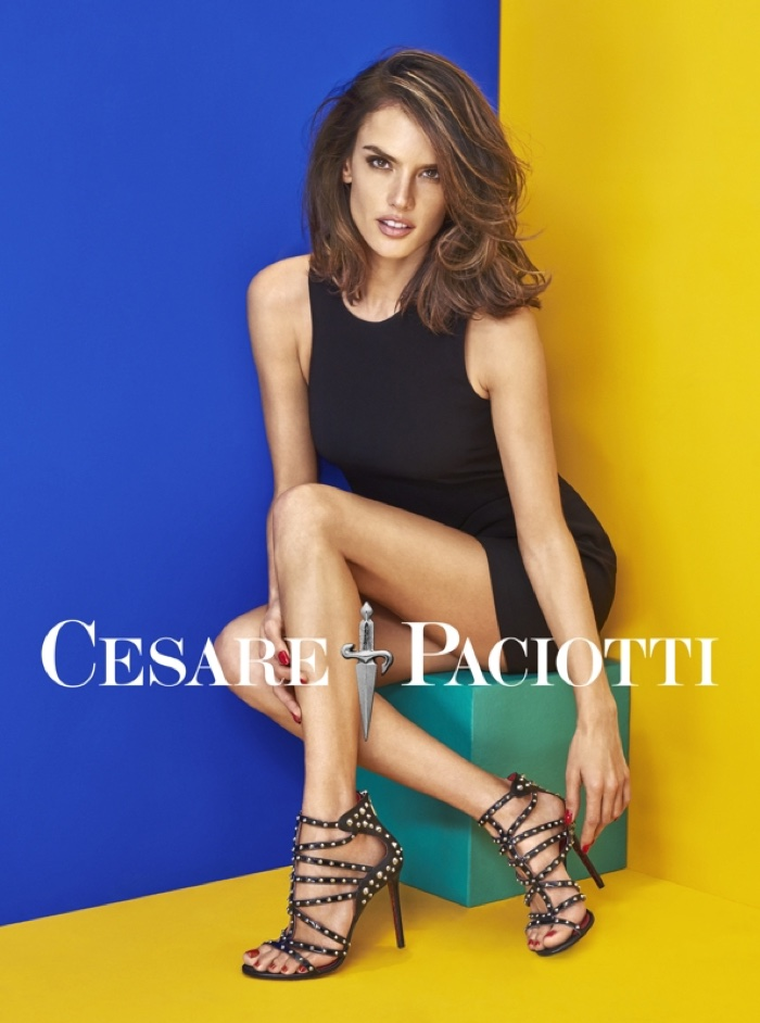 Alessandra Ambrosio models a pair of strappy sandals in Cesare ...