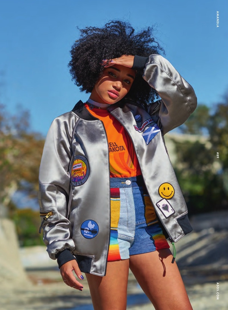 Amandla sports a bomber jacket and vintage denim shorts for the fashion feature