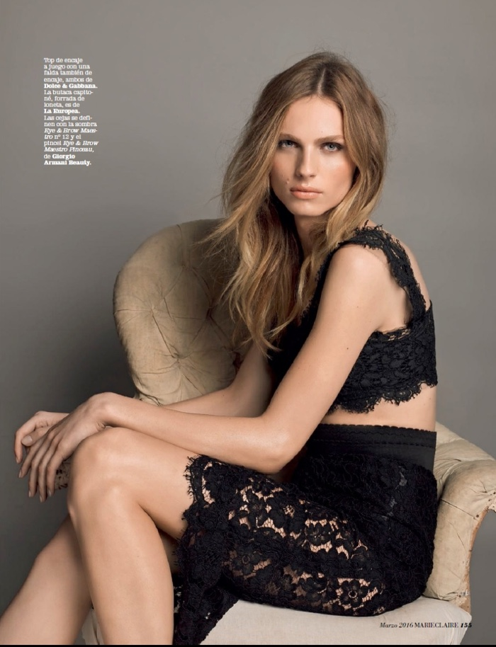 ... Andreja Pejic models black lace crop top with matching skirt from Dolce & Gabbana