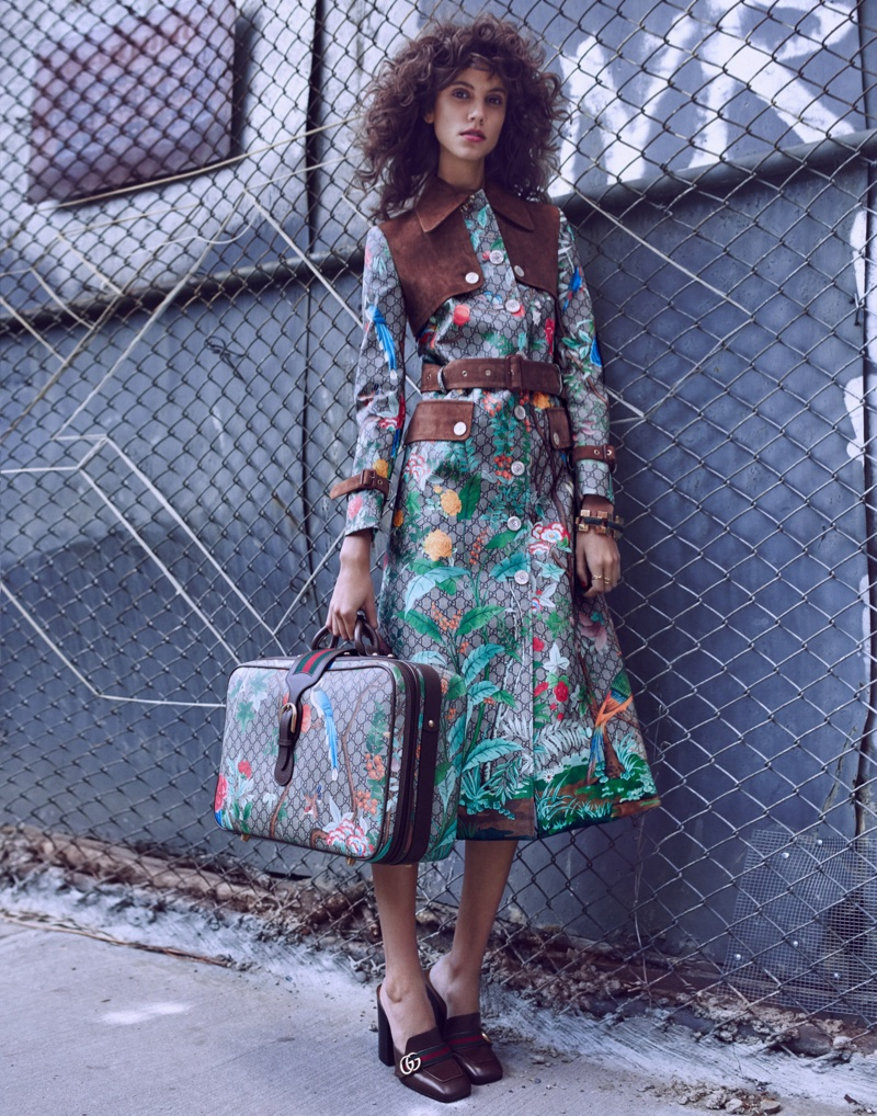 Antonina Petkovic poses outdoors in a Gucci coat with matching luggage