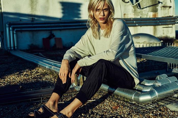 Aymeline poses in oversized sweatshirt and slim-fit pants