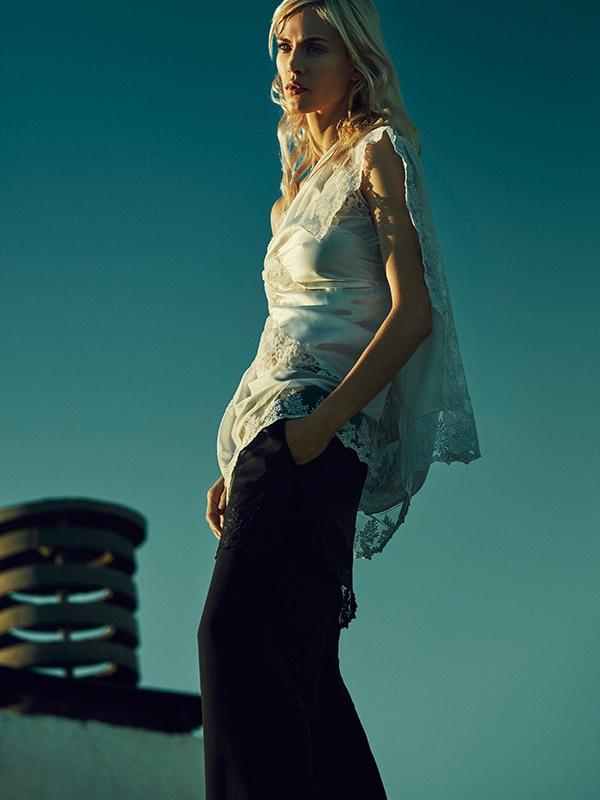 Aymeline models lace embellished top designed by Riccardo Tisci for Givenchy