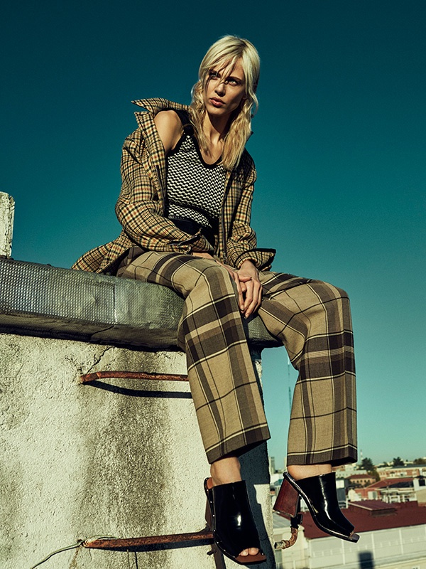 Aymeline looks tomboy chic in Celine checkered print coat and plaid trousers