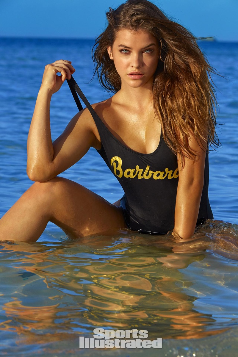 Barbara Palvin models a customized one-piece swimsuit in black