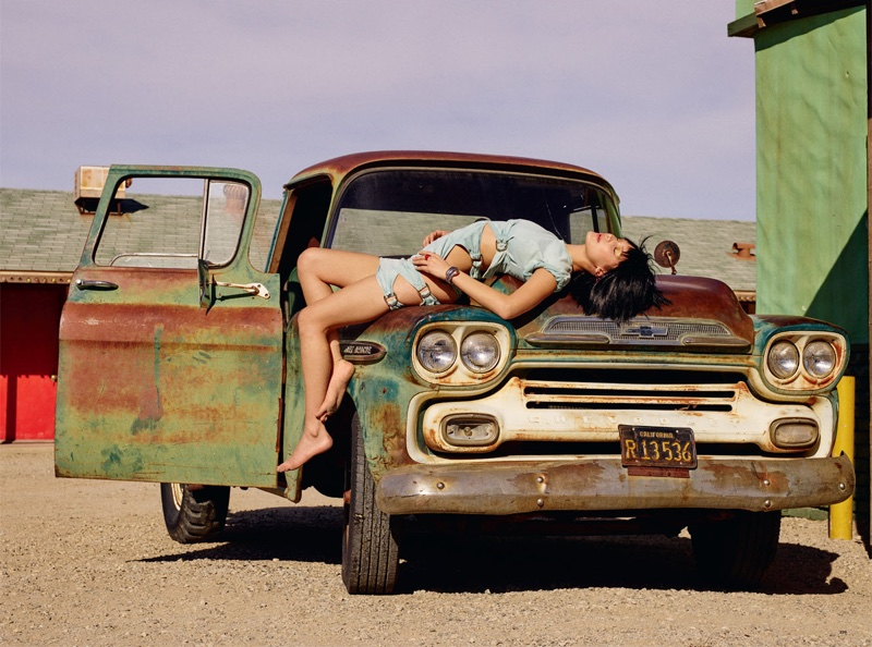 Photographed by Sam Taylor-Johnson, Bella Hadid poses with vintage cars for the fashion editorial