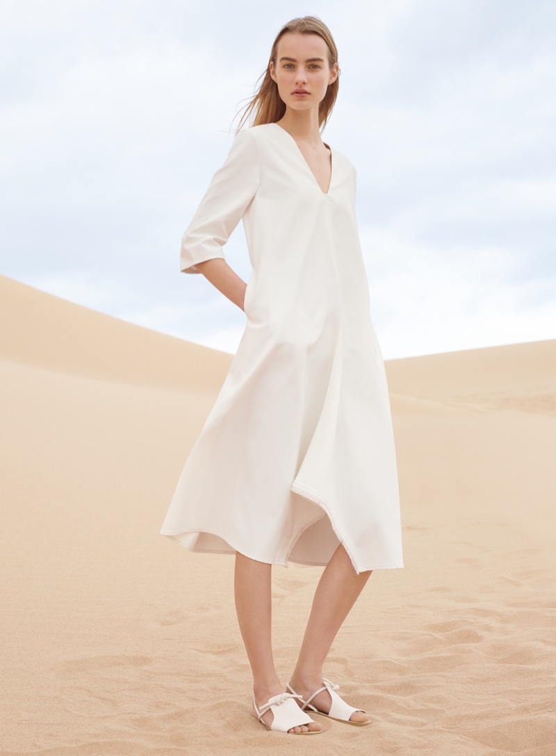 Maartje wears a crisp white tunic dress in COS' spring-summer 2016 campaign
