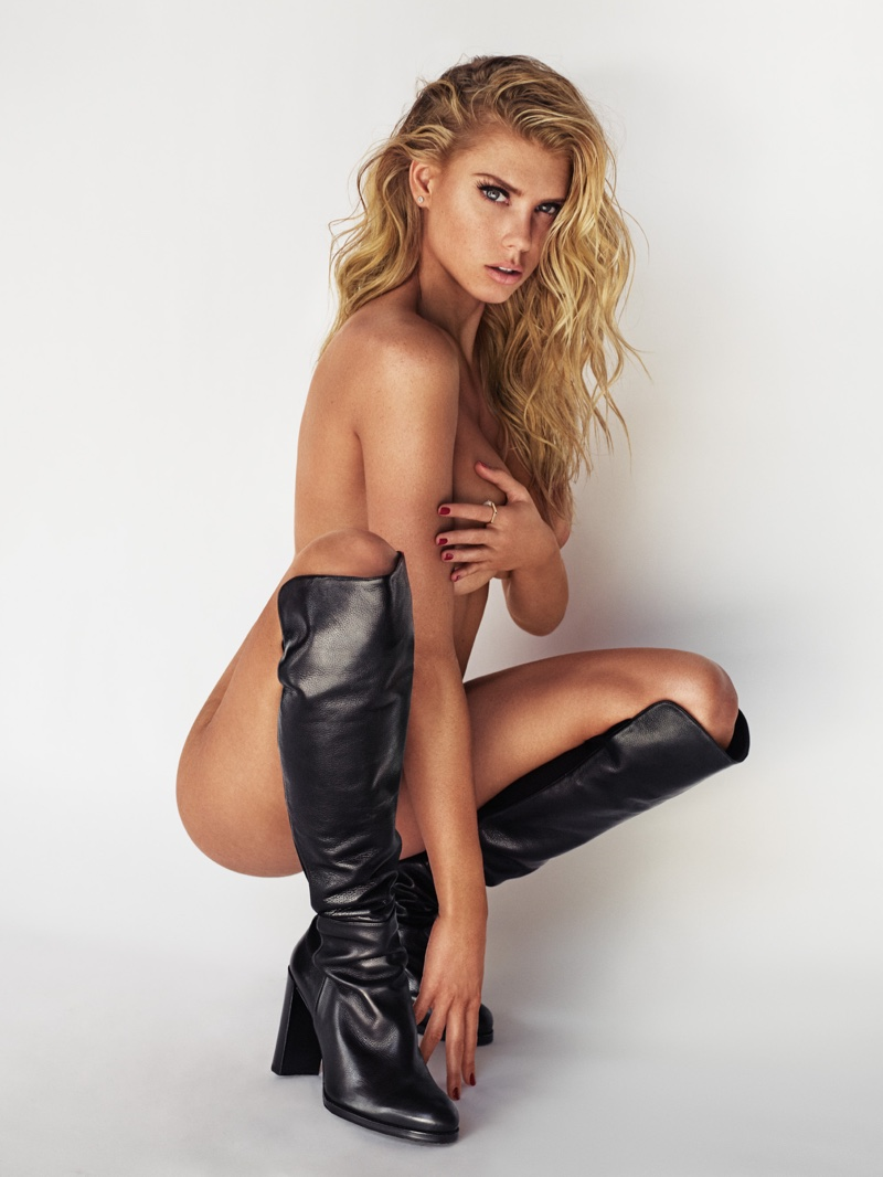 KINKY BOOTS: Charlotte McKinney wears black knee-high boots while posing naked