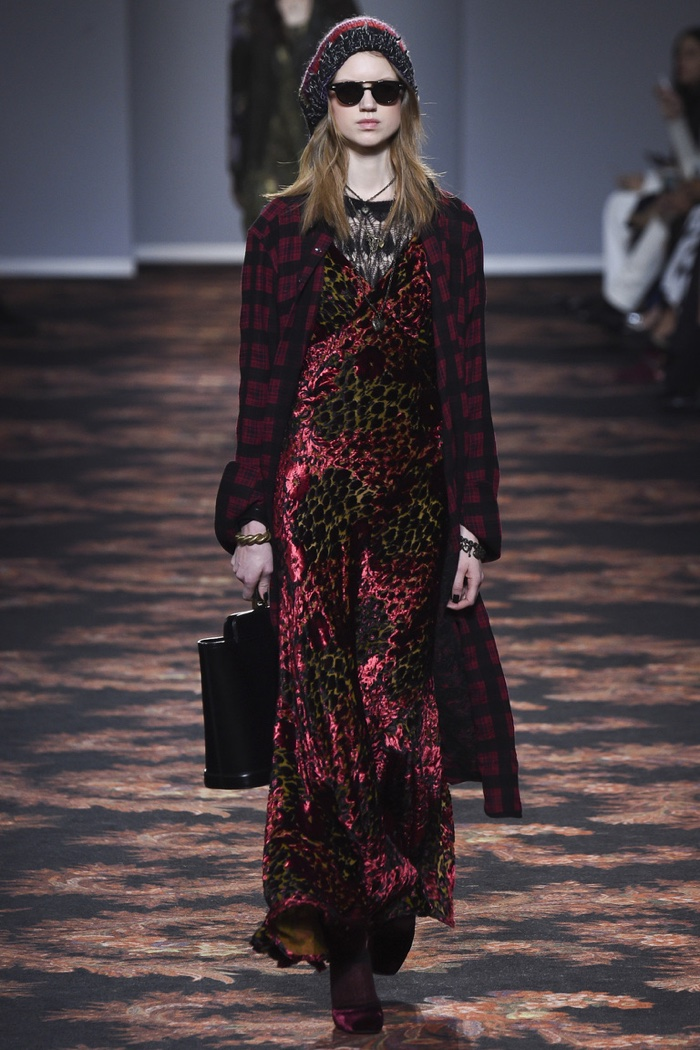 Model wears plaid coat over velvet dress with leopard detail on Etro's fall 2016 runway