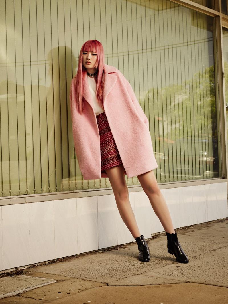 Fernanda wears a pink coat to match her pastel hair