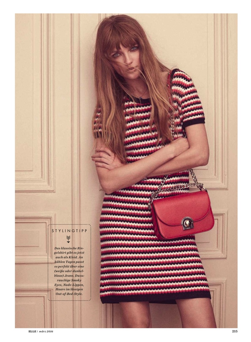 Vlada poses in a striped dress designed by Tommy Hilfiger
