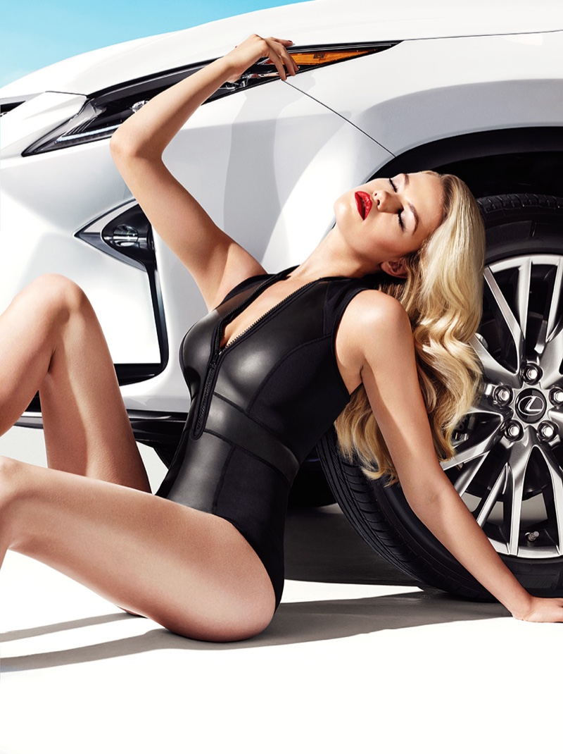 Hailey Clauson poses in black one-piece swimsuit for the new Lexus RX campaign
