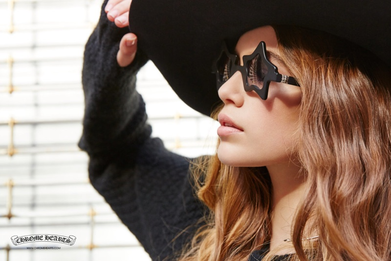 Kaia Gerber poses in wide-brimmed hat and star-shaped sunglasses in Chrome Hearts spring 2016 campaign
