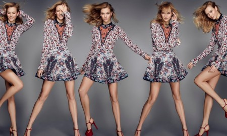 Karlie Kloss flaunts her long legs in a fit and flare dress