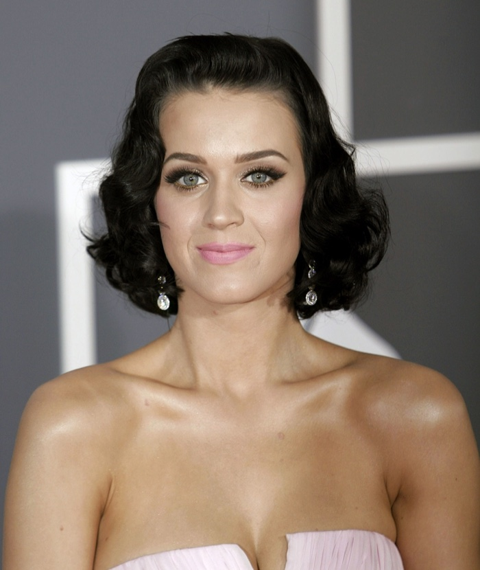 Katy Perry shows off a short and wavy black hairstyle evoking a bygone era. Photo: Everett Collection / Shutterstock.com