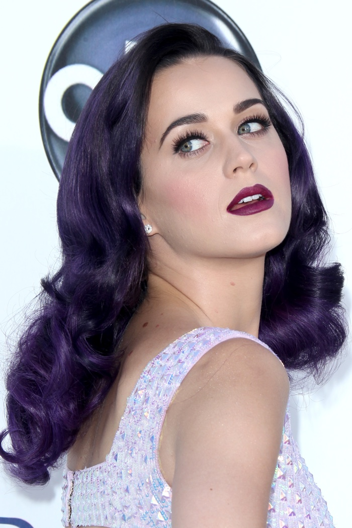 Katy Perry poses with a wavy dark purple hairstyle at the 2012 Billboard Music Awards. Photo: Helga Esteb / Shutterstock.com