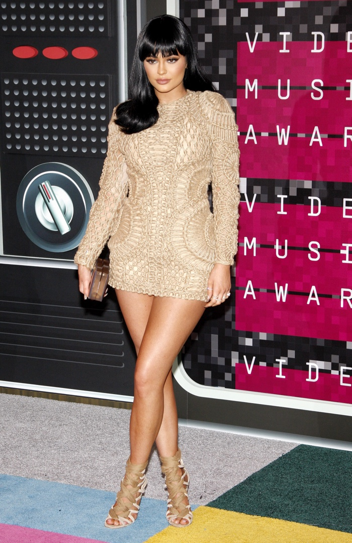 Kylie Jenner flaunts some leg in a beige Balmain mini dress at the MTV Video Music Awards in 2015. Photo: Tinseltown / Shutterstock.com