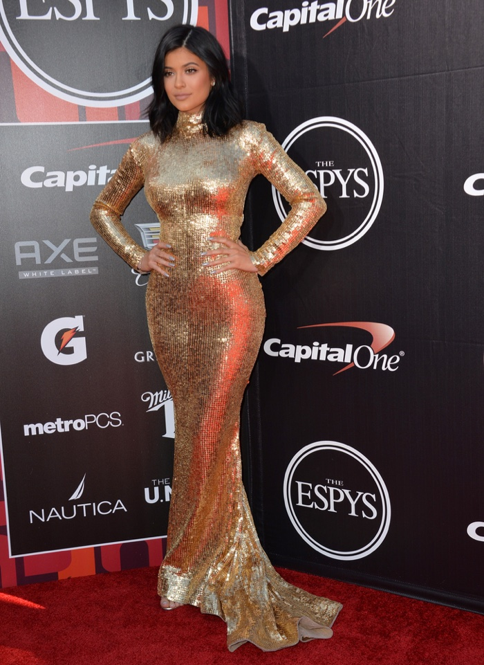 c6680de20c5 ... Kylie Jenner glittered at the 2015 ESPY Awards wearing a gold Shady  Zeineldine dress. Photo