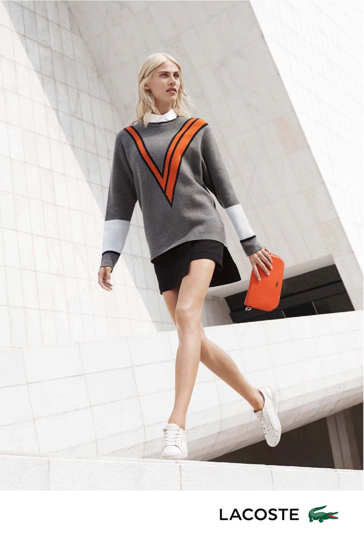 Aymeline strolls in a sweater, skirt and sneakers from Lacoste's spring 2016 collection
