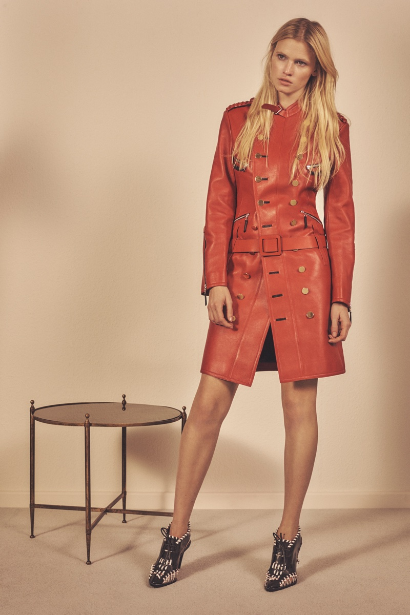 Lara Stone poses in red leather belted coat from Louis Vuitton