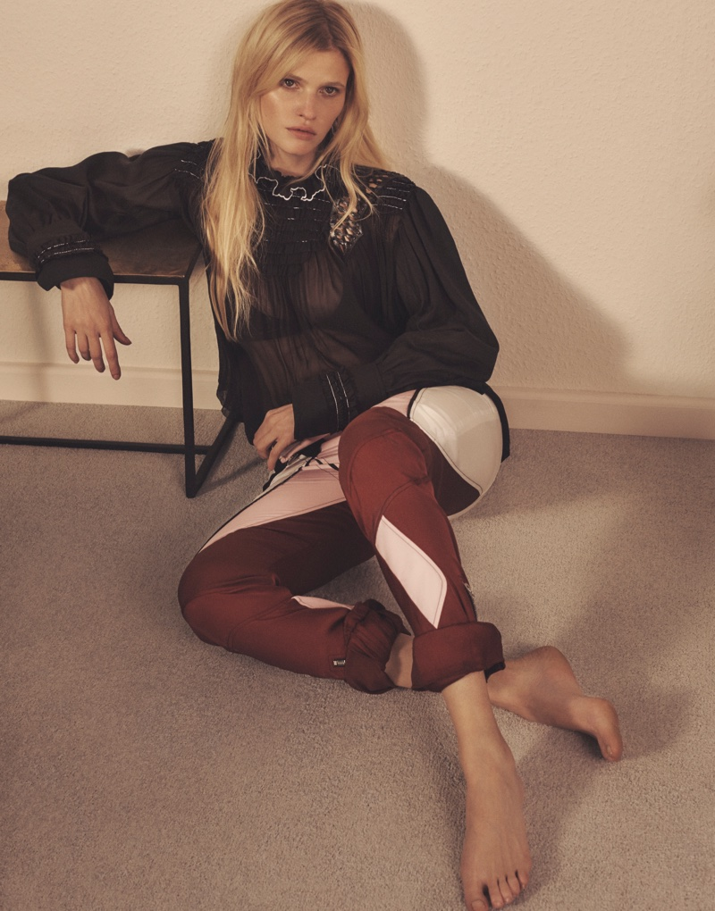 Lara Stone models sheer black top and color-blocked leather pants from Louis Vuitton