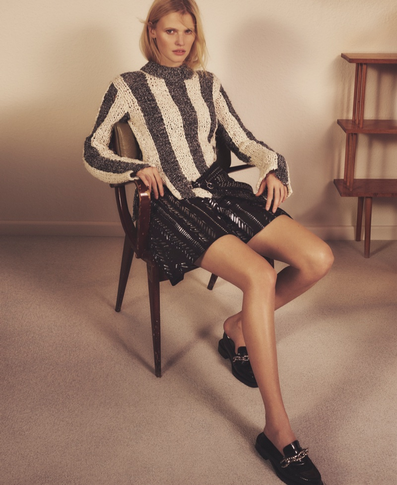 Lara Stone poses in a striped top and black mini skirt from Louis Vuitton's spring 2016 collection