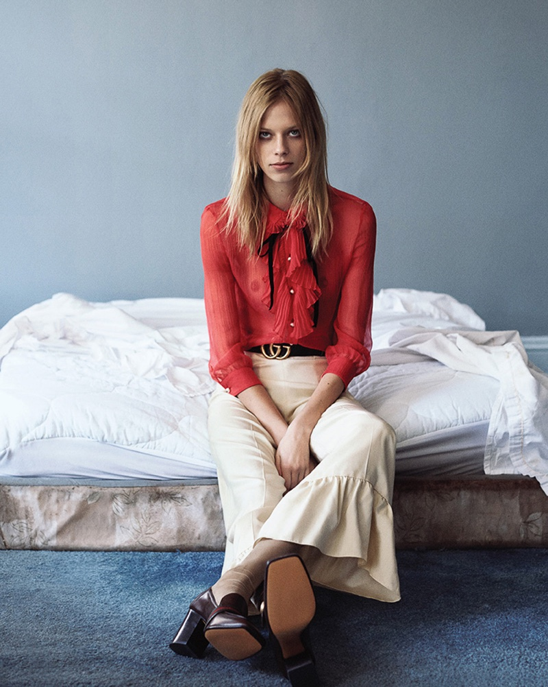 Lexi Boling models red Gucci shirt, white trousers and loafers