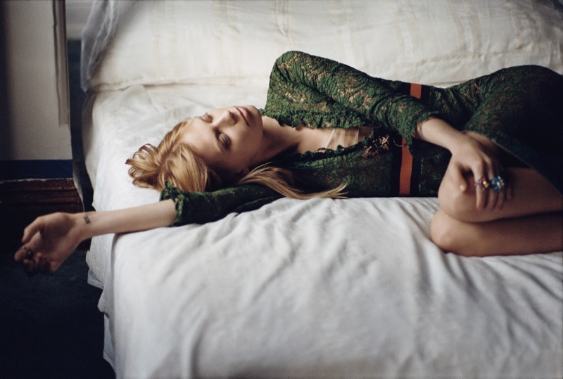 Lexi Boling lounges in a green Gucci dress