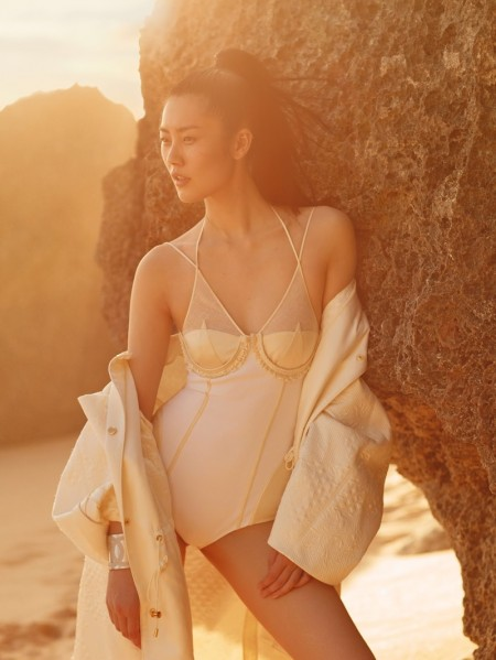Liu Wen poses on the beach wearing a La Perla bodysuit