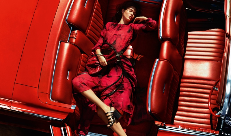 Vanessa Moody models a red floral print dress in Michael Kors' spring 2016 campaign