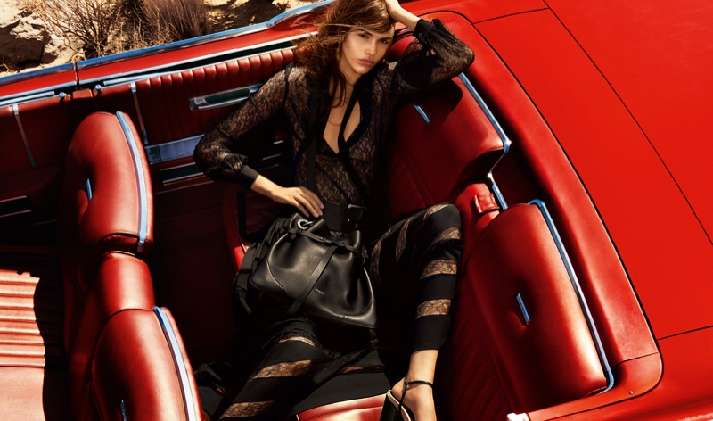 Vanessa Moody models a black maxi dress in Michael Kors' spring 2016 campaign