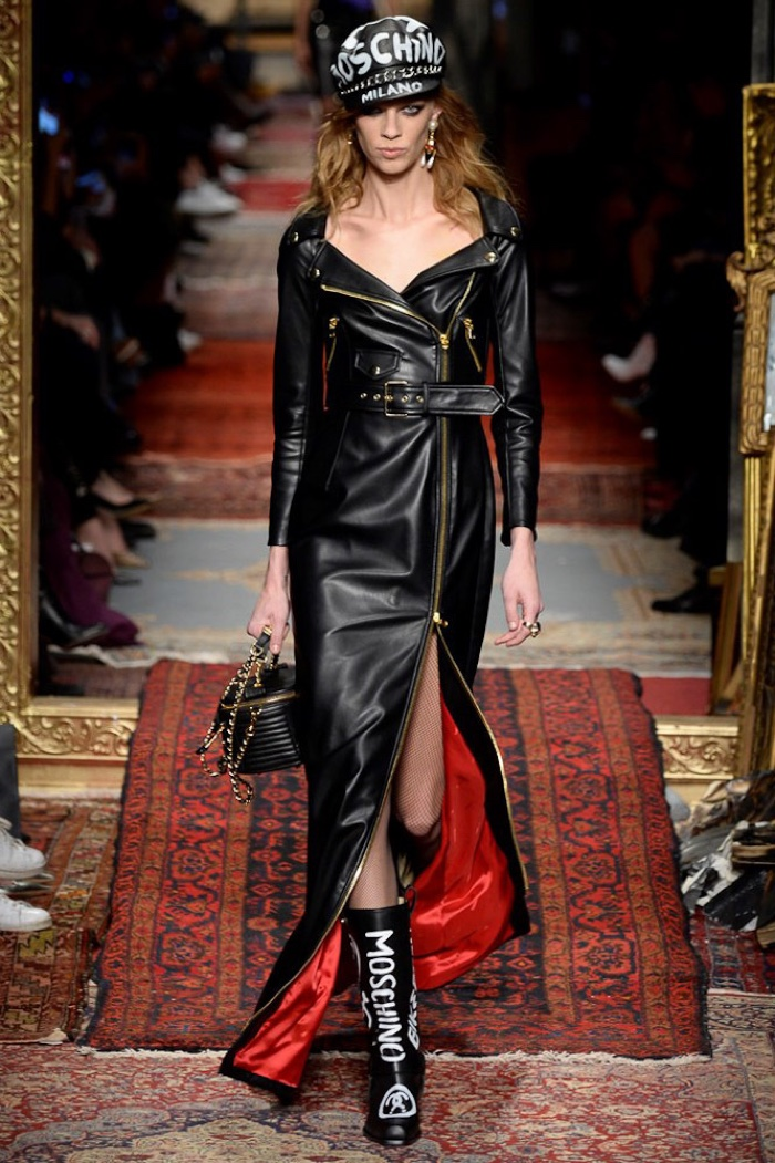 Lexi Boling walks the runway at Moschino's fall-winter 2016 show wearing a leather dress