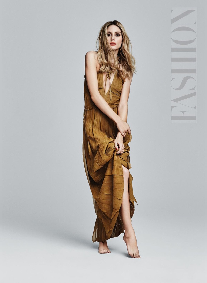 Olivia Palermo poses in Salvatore Ferragamo maxi dress