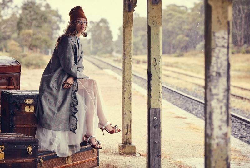 Photographed near train tracks, Ondria poses in a Miu Miu coat