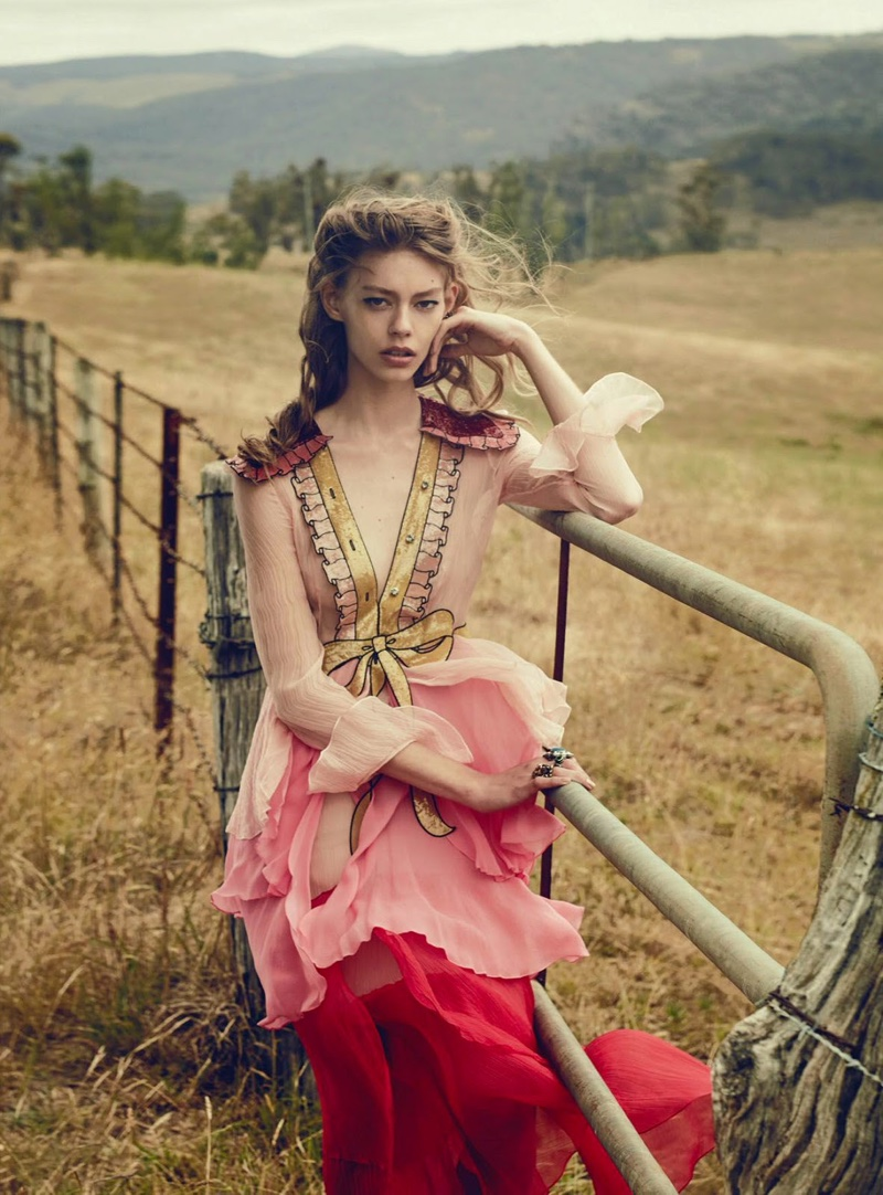 Ondria poses in field with a Gucci dress