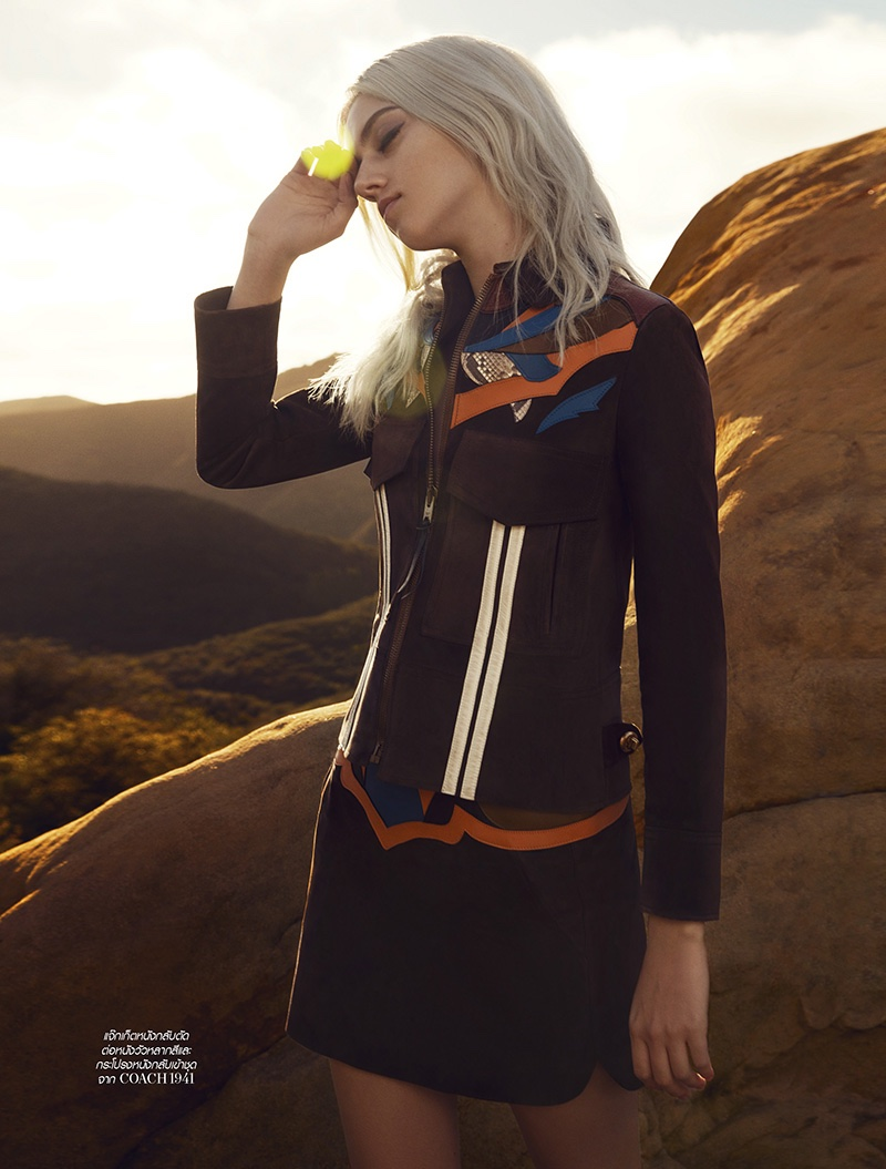 Pyper America poses in Coach jacket and skirt