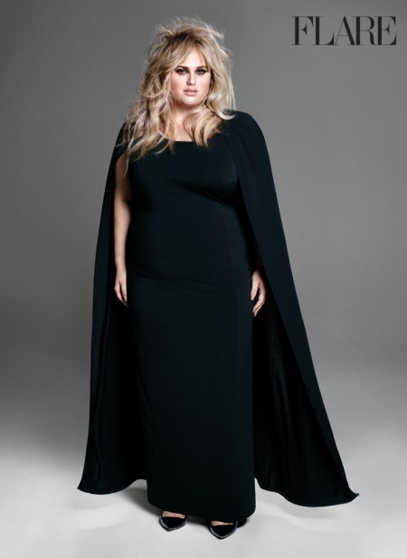 Rebel Wilson poses in black cape and gown
