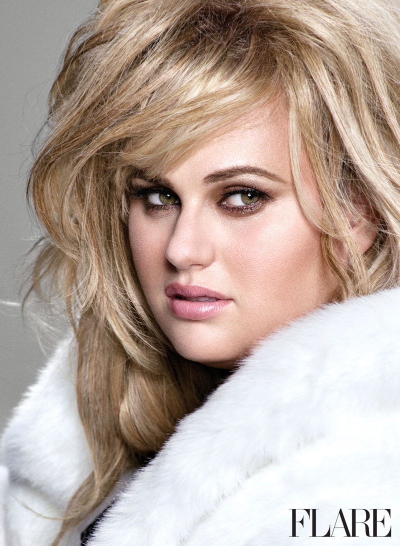 Rebel Wilson pumps up the glam in a white faux fur look