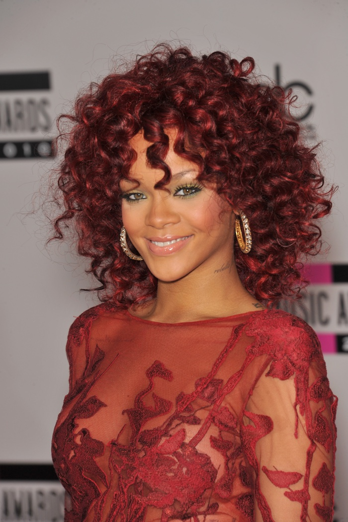 Singer Rihanna gave red hair a try with a medium-length curly style at the 2010 American Music Awards. Photo: Featureflash / Shutterstock.com
